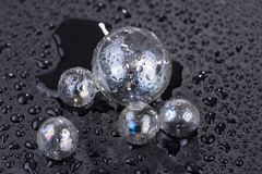 Transparent glass sphere with water drops isolated on black. Background Stock Photography
