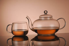 Transparent glass teapot and cup with tea Stock Photography