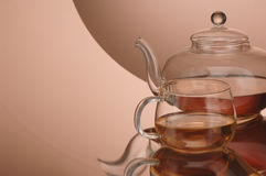 Transparent glass teapot and cup with tea Stock Image