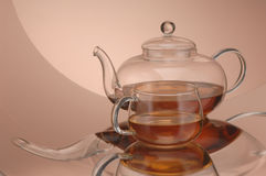 Transparent glass teapot and cup with tea Royalty Free Stock Images