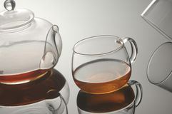Transparent glass teapot and cup with tea Royalty Free Stock Photo