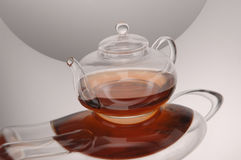 Transparent glass teapot and cup with tea Royalty Free Stock Image
