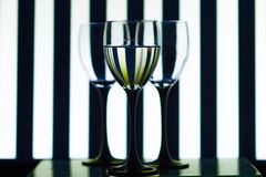 Glass glasses on the background strips stock images