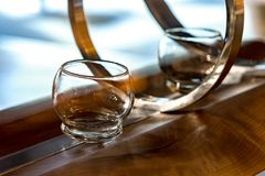 Transparent glasses on wooden counter close-up Royalty Free Stock Image