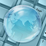 Transparent globe with keyboard Royalty Free Stock Photo