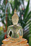 Transparent gold Buddha statue Stock Images