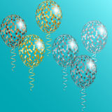 Transparent Golden and silver balloons with spangles, confetti and streamers Royalty Free Stock Photography