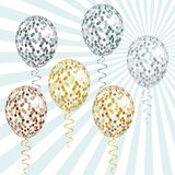 Transparent Golden and silver balloons with spangles, confetti and streamers Stock Photography