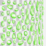 Transparent green drops flowing along a cylindrical surface Stock Image