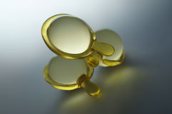 Transparent Hair Vitamin Capsules Royalty Free Stock Photography