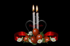 Transparent heart with burning candles, Easter eggs and white flowers. Card with transparent heart with burning candles, Easter Eggs and white flowers on black Royalty Free Stock Photography