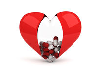 Transparent heart with pills inside Stock Photography