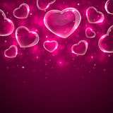 Transparent hearts on pink background Stock Photo