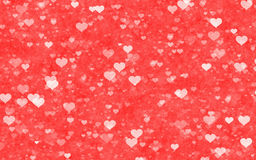 Transparent hearts on red delicacy backgrounds Stock Photo