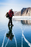 Transparent ice and clear blue sky on Lake Baikal. Photographer Stock Image