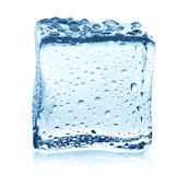 Transparent ice cube with reflection on blue glass with water drops Stock Images