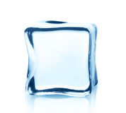 Transparent ice cube with reflection isolated on white. Stock Image