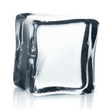 Transparent ice cube with reflection  on white. Royalty Free Stock Image