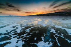 Pattern on ice of lake Baikal during sunset. Siberia Russia stock images