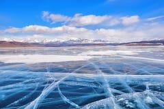 Transparent ice large mountain lake Stock Photography