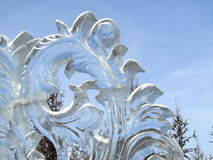 Transparent ice sculpture against the sky Stock Photography