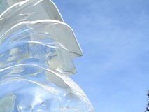 Transparent ice sculpture against the sky Stock Images