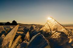 View on and throug ice during sunset on Lake Baikal. Russia, Siberia royalty free stock photo