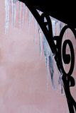 Transparent icicles hanging from the porch Royalty Free Stock Photo