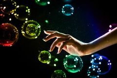 The transparent, iridescent soap bubbles isolated on black. stock photo