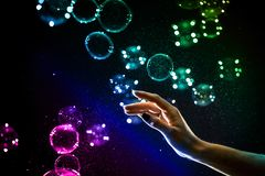 The transparent, iridescent soap bubbles isolated on black. royalty free stock photo