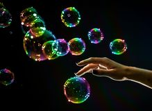 The transparent, iridescent soap bubbles isolated on black. stock image