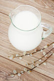 Milk on wooden table Royalty Free Stock Photography