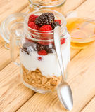 Transparent jar with berries and yogurt cereals Royalty Free Stock Photography
