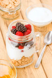 Transparent jar with berries and yogurt cereals Royalty Free Stock Photo