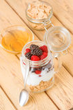 Transparent jar with berries and yogurt cereals Royalty Free Stock Image