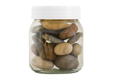 Transparent jar with different stones Royalty Free Stock Photography
