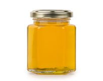 Transparent jar of liquid honey Royalty Free Stock Image
