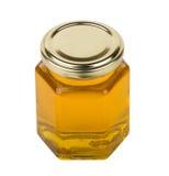 Transparent jar of liquid honey stock image
