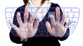 Transparent keyboard. Girl typing on transparent keyboard Stock Images