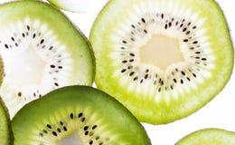 Transparent kiwifruit slices Royalty Free Stock Image