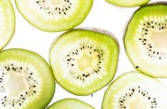 Transparent kiwifruit slices Royalty Free Stock Photography