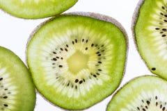 Transparent kiwifruit slices Stock Photo