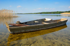 Transparent lake with small wooden boats Stock Photography