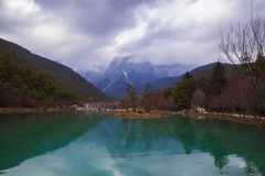 Transparent lake water with mountain Royalty Free Stock Photo