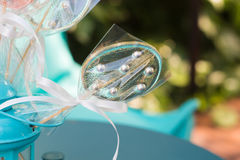 Transparent lollypop. Lollypop in turquoise lantern on the turquoise table Royalty Free Stock Image