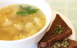 Transparent broth with rye toast stock image