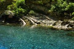 Transparent mountain stream Stock Photo