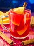 Transparent mug with citrus mulled wine Stock Photos