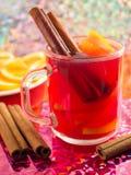 Transparent mug with citrus mulled wine, cinnamon and orange Royalty Free Stock Image