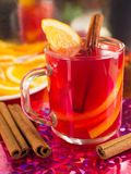 Transparent mug with citrus mulled wine, cinnamon and orange Royalty Free Stock Photography